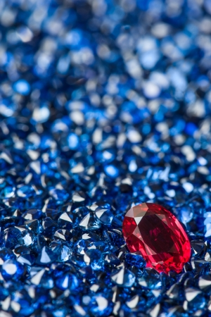 Oval ruby in sappire field Stock Photo
