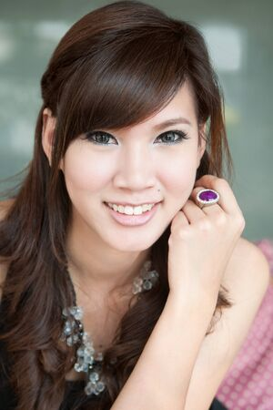 Beautiful young woman smiling. Portrait of asian woman. Stock Photo