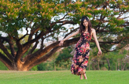 Beautiful young asia  woman in color dress posing outdoor photo