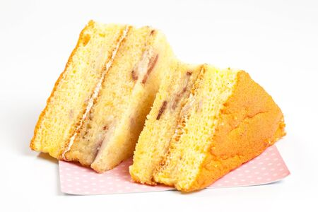 2 peice of yellow cake on a white background side view
