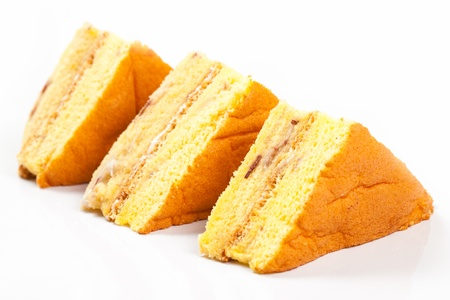 3 peice of yellow cake on a white background side view