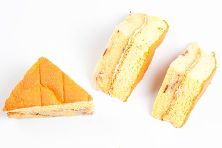 3 peice of yellow cake on a white background top view Stock Photo