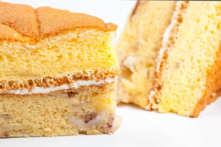 Close up of yellow cake on a white background