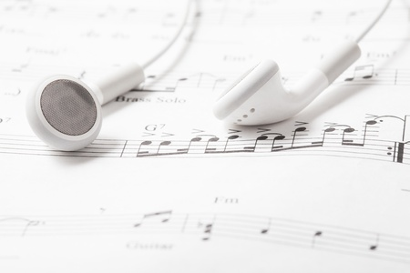 White earphones on a music note photo