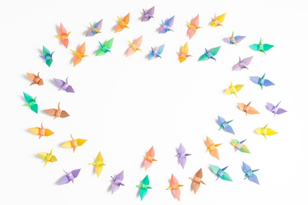 Colorful paper birds on white background.