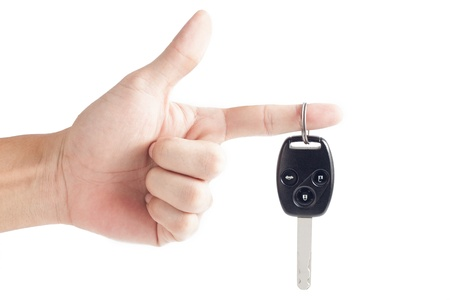 Car key remote with hand on white photo