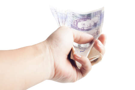 Holding twenty pound notes in hand Stock Photo