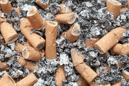 Many cigarette butts background Stock Photo