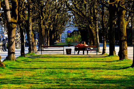 A young couple sitting in the Mirabell parks, Salzburg
