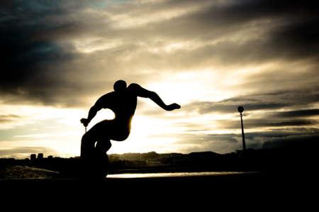 northshore: Back light of a surfer sculpture
