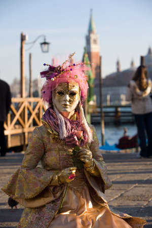carnivale: Lady in venetian mask near Piazza San Marco