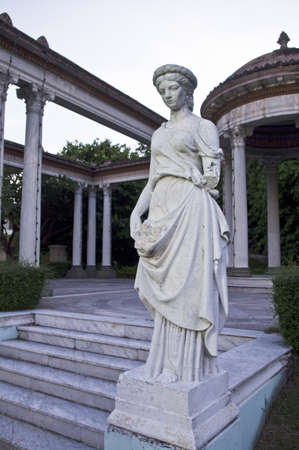 antique woman statue in the park Stock Photo