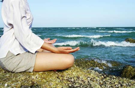 woman yoga at the sea Stock Photo - 10014067