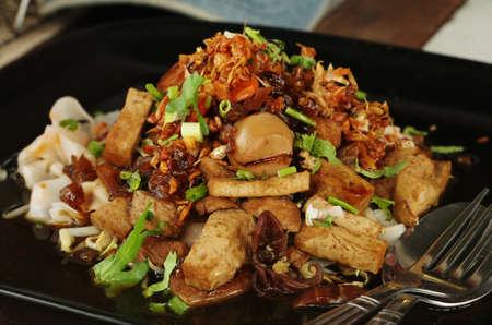 rice noodles in black bowl Standard-Bild