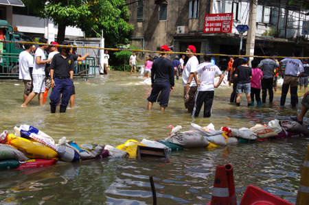 pollution water: BANGKOK - OCT 30: Unidentified residents of Bangkok
