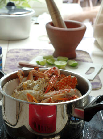 Steaming red crabs in a kitchen pot