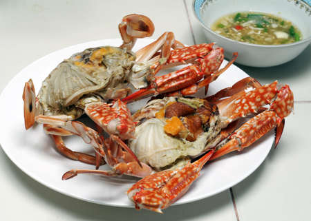 Steamed red crabs on a white plate Stock Photo