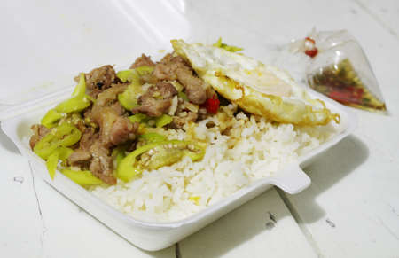 Foam take out container Thai food Standard-Bild