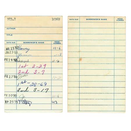 dattes: Avant et arri�re d'un ancien livre de biblioth�que date d'�ch�ance de la carte de 1960 isol� sur un fond blanc. Derni�re num�riquement les noms ont �t� retir�s, ainsi que le titre et l'auteur de l'ouvrage.