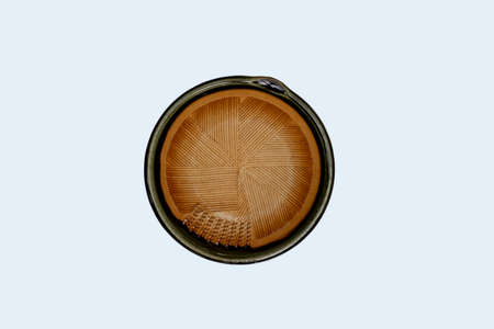 Top view-Empty brown ceramic round dish plate isolated on white background.