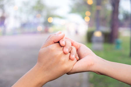 Couples hold hands together in love garden.