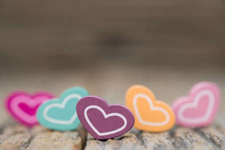 Many color Heart on wooden background. Copy space Valentines day concept.
