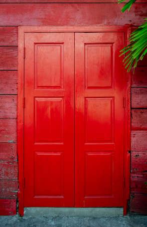 Old red typical vintage wooden door.