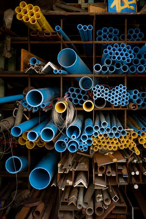 Blue and yellow PVC pipes in warehouse. 免版税图像