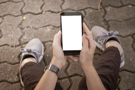 Hand using  Mobile Phone urban street.