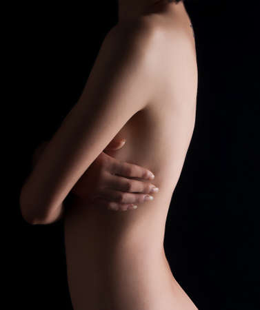Female nude on a black background