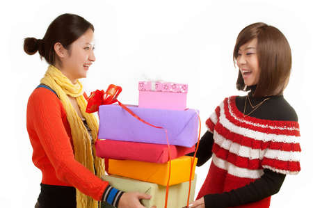 Two girl holding a gift
