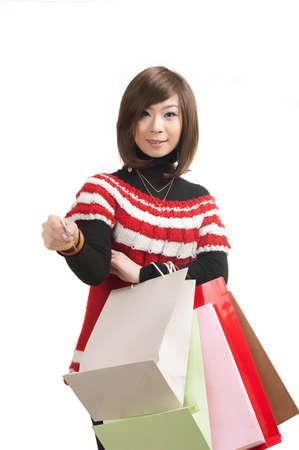happy teenage Asian girls on a shopping MasterCard Stock Photo - 13310537