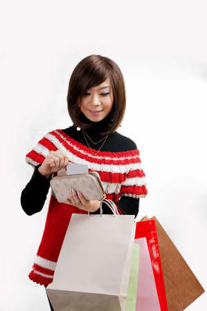 happy teenage Asian girls on a shopping MasterCard  Stock Photo