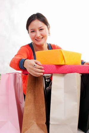 Shopping woman smiling holding shopping bags  photo