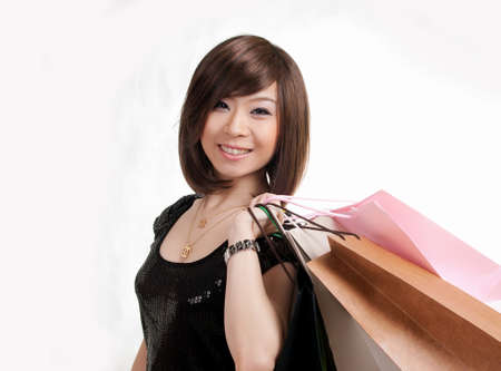 Happy girl carrying shopping bags Stock Photo