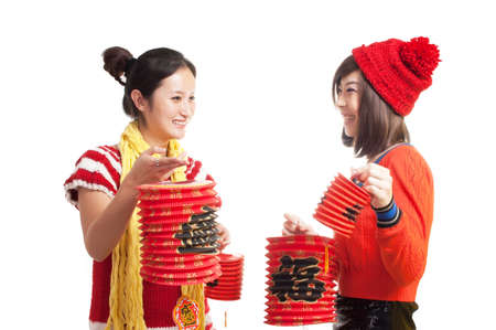 Two girls with lanterns to celebrate the Chinese traditional festival
