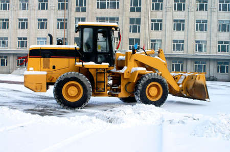 snow plow: Snow removal vehicle removing snow