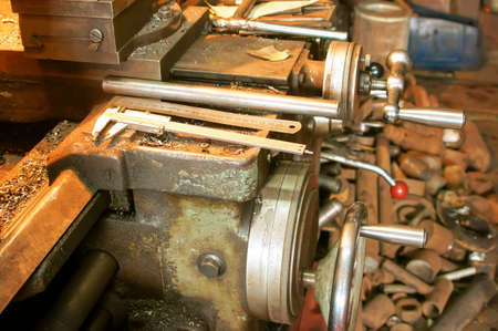 The Old lathe in the manufacture solution, close-up photo