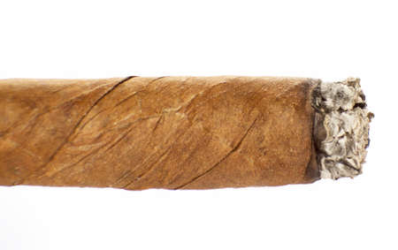 Burning cuban cigar isolated on a white background Stock Photo