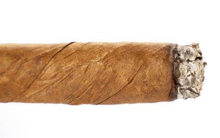 Burning cuban cigar isolated on a white background Stock Photo
