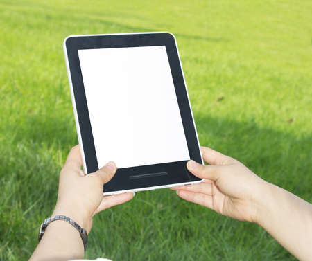 Woman hands holding electronic tablet pc with blank screen.  Stock Photo - 15000688