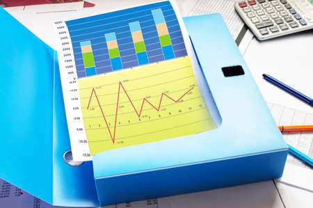 Financial paper charts and graphs on the table Stock Photo - 16231473