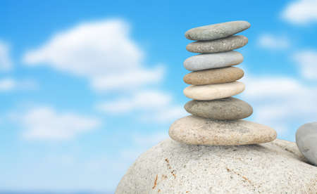 piles of stones balanced on a sky background Stock Photo