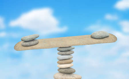 imbalance: piles of stones balanced on a sky background Stock Photo