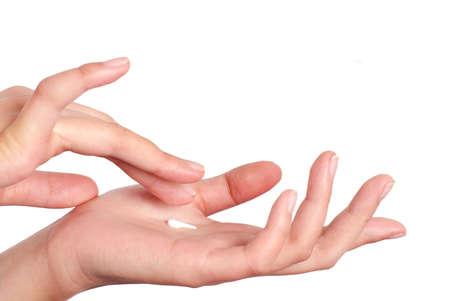 The woman rub hand cream