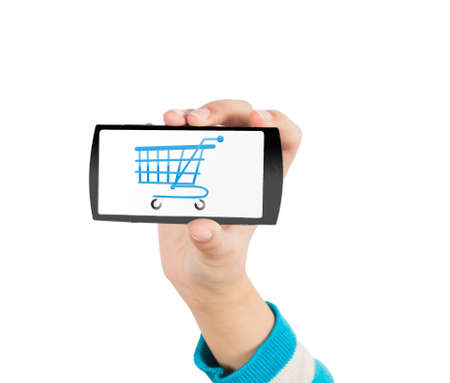 Mobile phone and shopping cart Stock Photo - 17502344
