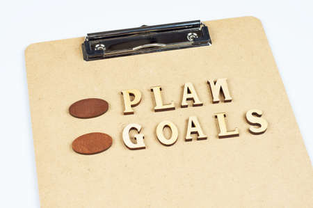 smart goals: goal and plan word on the folder