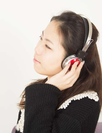revel: Young woman revel in music with headphones.