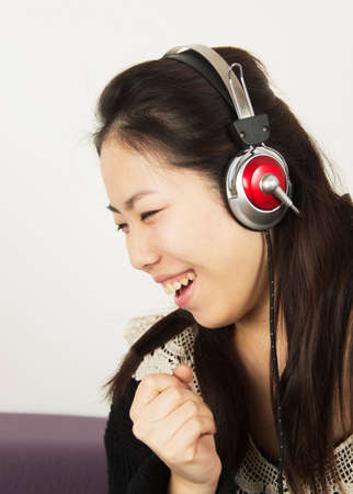 Young woman feeling happy listening music with headphones. photo