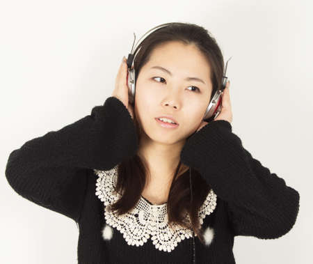 revel: Young woman revel in music Stock Photo
